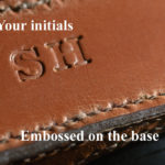 Close up embossed initials on Leica Q camera case
